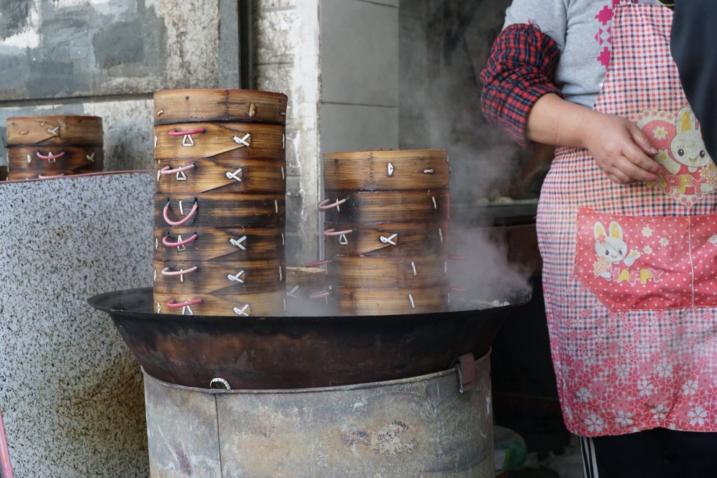 On our last morning in Beijing, before heading to the airport, we took a walk and found a lady making dumplings.