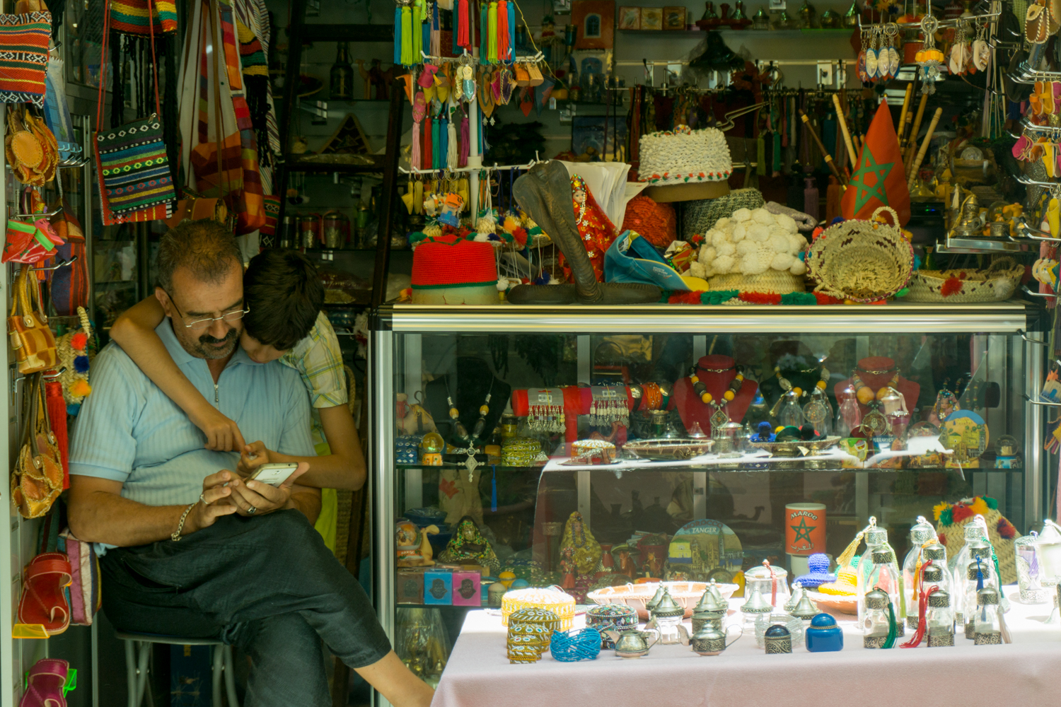 A shopkeeper and his son in Tangier's medina
