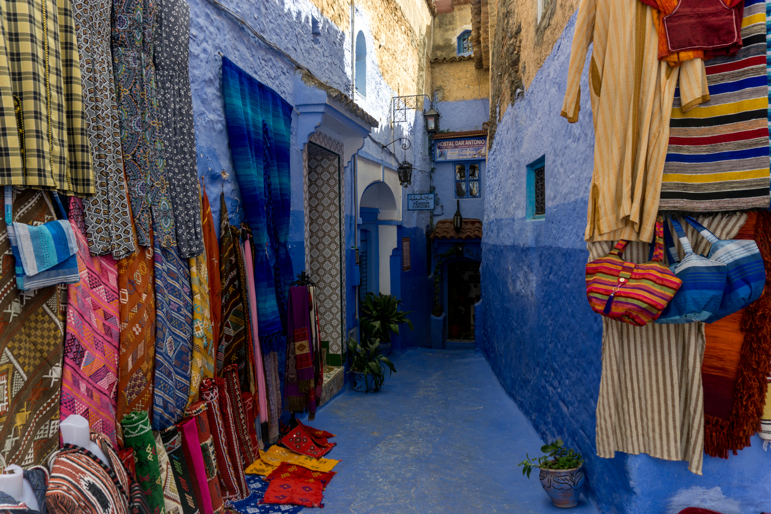 The blue walls are interrupted by brightly colored cloth.