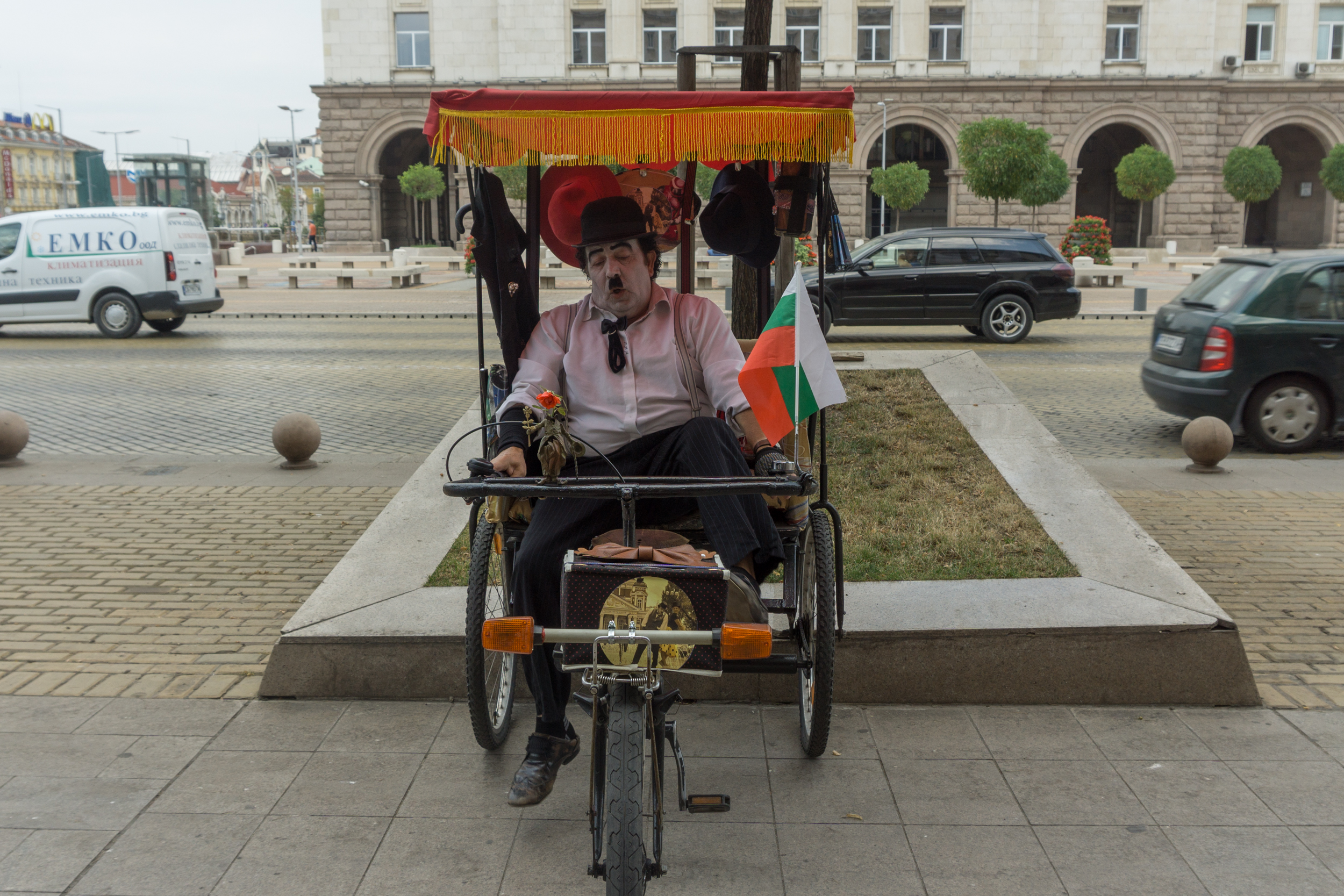 Bulgaria: A gentleman relaxing in a pedicab